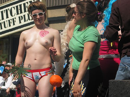 A bare-breasted lesbian with pierced nipples in the 2004 Toronto dyke parade.