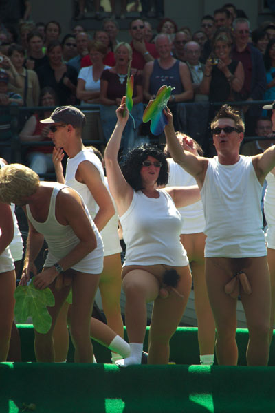 Homosexuals dancing lewdly during the 2004 gay pride parade in Amsterdam, Netherlands.